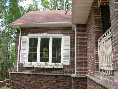 фасады домов из искусственного камня